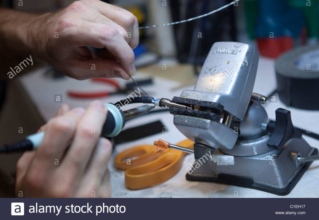 a stock image of soldering close-up